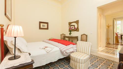 A bed or beds in a room at Portico Ottavia Garden Apartment