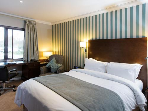 A bed or beds in a room at Kettering Park Hotel and Spa