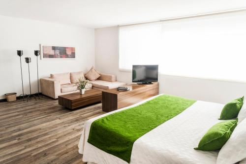 A television and/or entertainment center at Hotel Bogota Virrey
