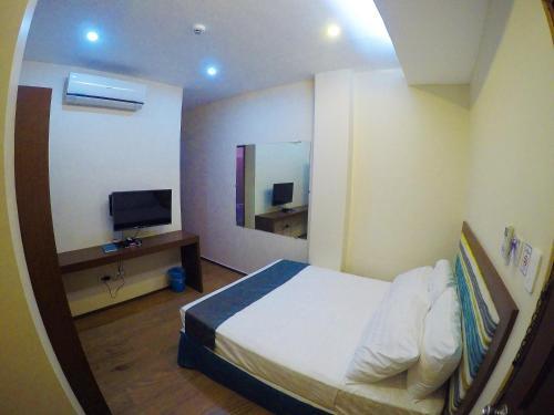 Cama o camas de una habitación en Golden Gate Suites