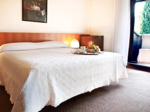 Letto o letti in una camera di Hotel Due Mori