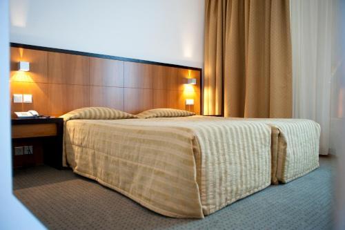 Un ou plusieurs lits dans un hébergement de l'établissement Hotel Bagoeira