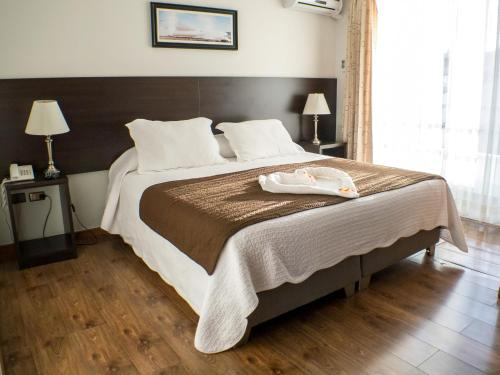 A bed or beds in a room at Hotel & Spa Las Taguas