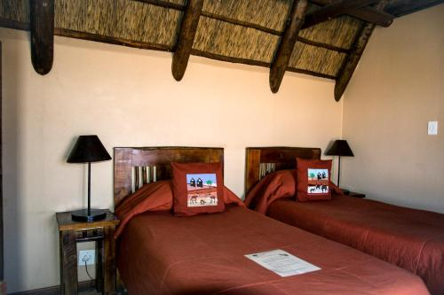 A bed or beds in a room at Xaus Lodge