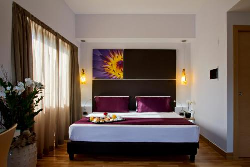 A bed or beds in a room at Hotel Gravina San Pietro