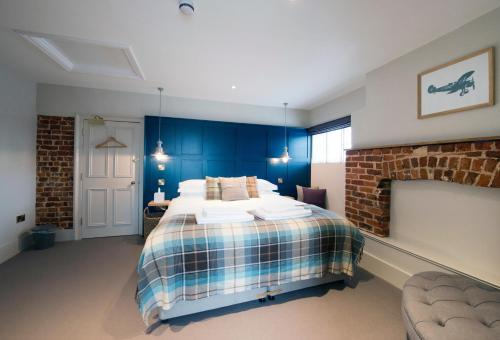 A bed or beds in a room at The Coach House