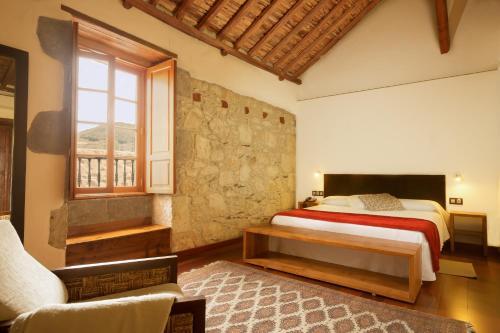 Cama o camas de una habitación en Hotel Rural El Mondalón