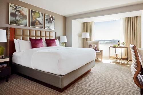 A bed or beds in a room at Lansdowne Resort and Spa