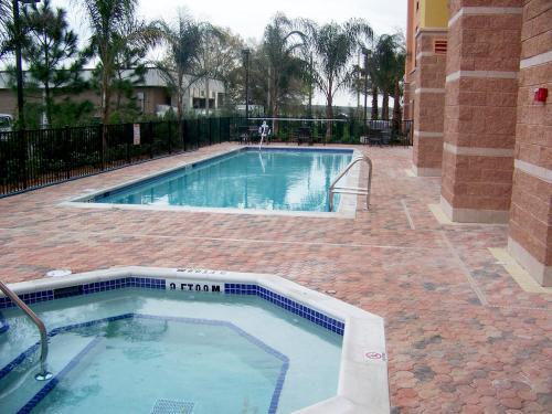 The swimming pool at or near Hampton Inn & Suites Orlando-South Lake Buena Vista