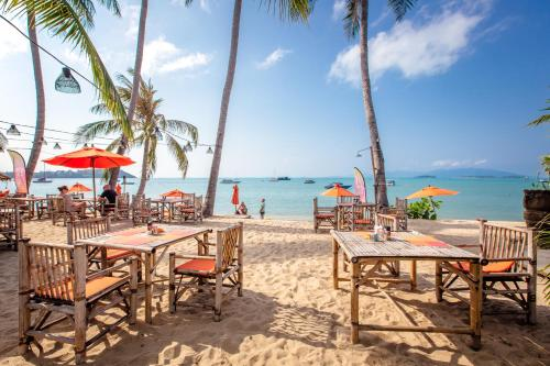 A restaurant or other place to eat at Secret Garden Beach Resort
