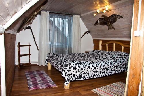 Кровать или кровати в номере База отдыха Заимка Рыбная