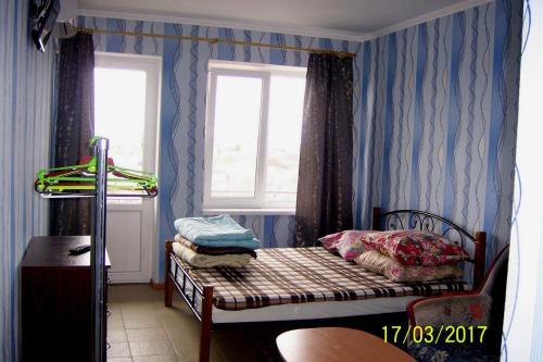 Кровать или кровати в номере Гостевой дом Бухта Радости