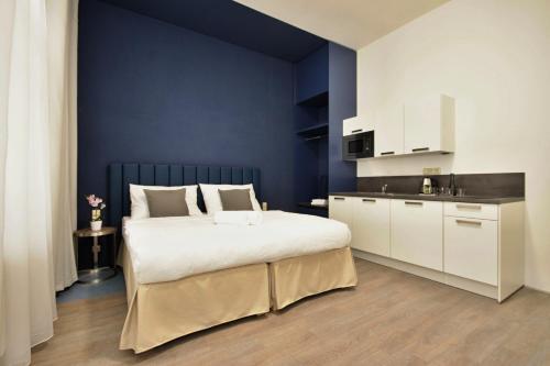 Letto o letti in una camera di Alveo Suites