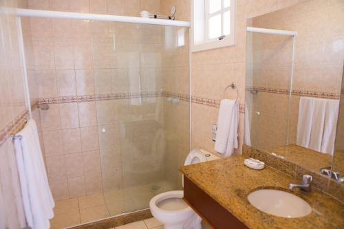 Um banheiro em Pousada Marbella Inn
