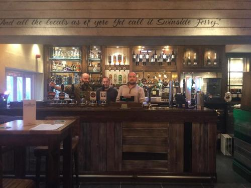 The lounge or bar area at Swinside Inn