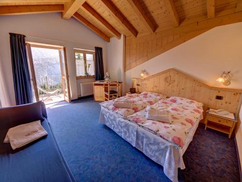 A bed or beds in a room at Hotel Negritella