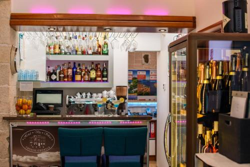 The lounge or bar area at Hotel Vila Sikaa