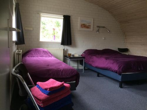 Een bed of bedden in een kamer bij Vlinderhuis 21C