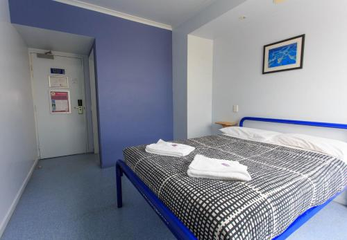 A bed or beds in a room at Cairns Central YHA