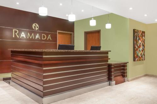 The lobby or reception area at Ramada by Wyndham Carlyle