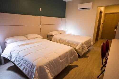 Кровать или кровати в номере Maitá Palace Hotel