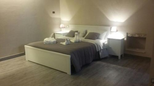 A bed or beds in a room at Ninna Nanna