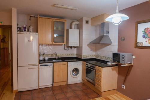 A kitchen or kitchenette at Ganbara