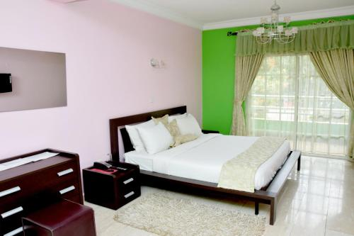 A bed or beds in a room at Deluxe Suites Superior Accommodation