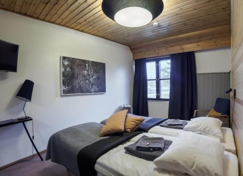 Vuode tai vuoteita majoituspaikassa Fell Centre Kiilopää, Hotelli Niilanpää