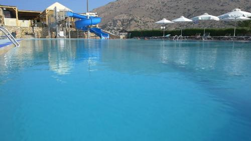 The swimming pool at or near Dolphin Bay Family Beach Resort