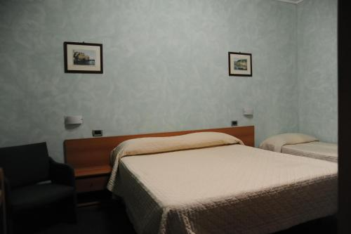 A bed or beds in a room at Hotel Valentini Inn