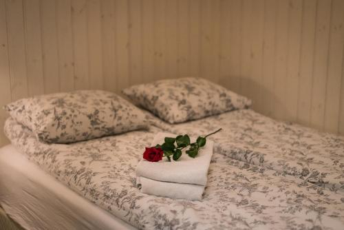 A bed or beds in a room at Sea Side Cottages