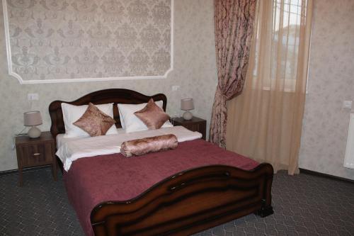 Кровать или кровати в номере Hotel Avlabari