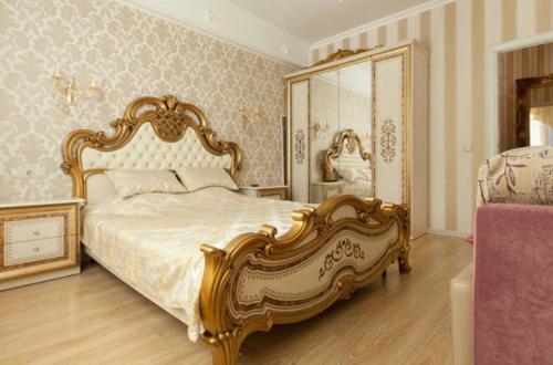 Кровать или кровати в номере Apartment by Kremlin