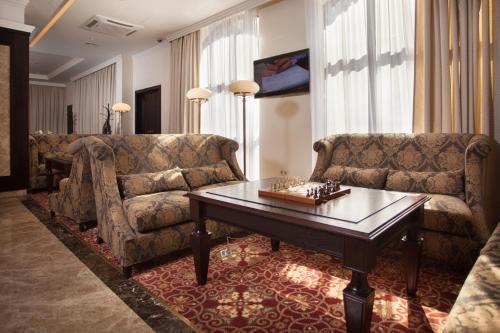 Гостиная зона в Бизнес-Отель Континенталь
