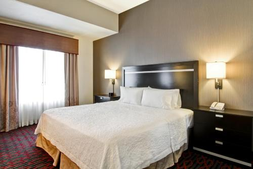 A bed or beds in a room at Hampton Inn & Suites Red Deer