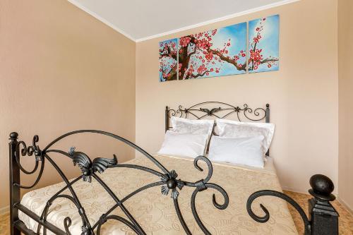 Кровать или кровати в номере Apartments on Lenina street