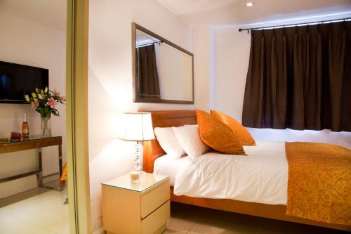 A bed or beds in a room at City Inn Russell Square