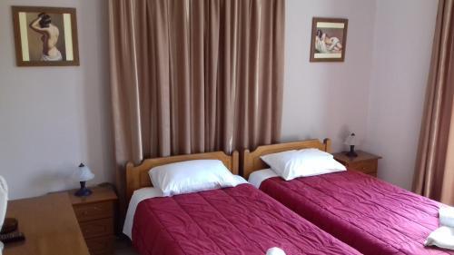 Ένα ή περισσότερα κρεβάτια σε δωμάτιο στο Ενοικιαζόμενα Δωμάτια 'Καμπάνης'