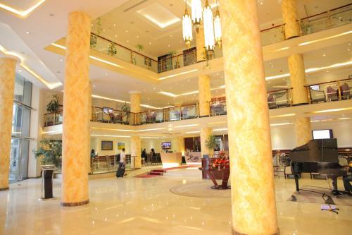 The lobby or reception area at Elilly International Hotel