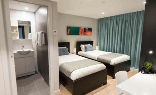 A bed or beds in a room at Studio 8 Residences - Adults Only