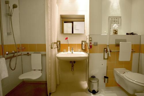 Ein Badezimmer in der Unterkunft Atlas Hotel