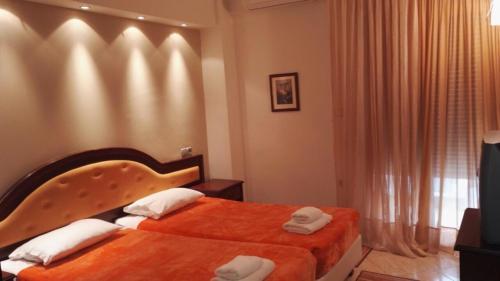 Кровать или кровати в номере Filippos