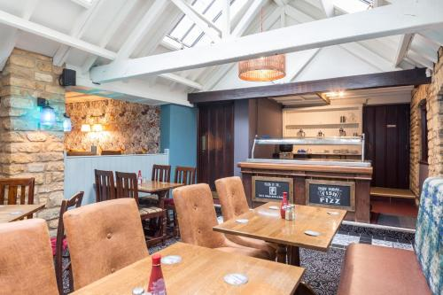 A restaurant or other place to eat at Duke of Wellington