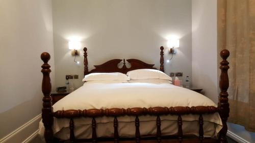 A bed or beds in a room at The Shirley