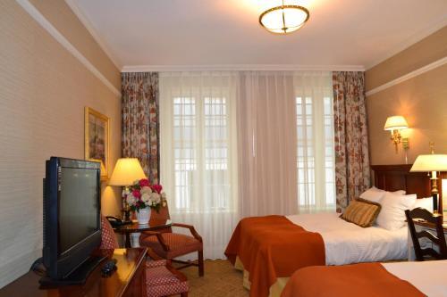 Cama o camas de una habitación en The Wall Street Inn