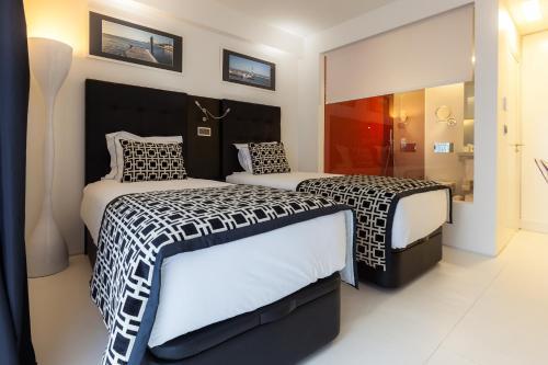 Uma cama ou camas num quarto em Faro Boutique Hotel
