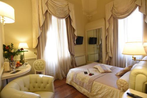 Letto o letti in una camera di Suite Hotel Santa Chiara