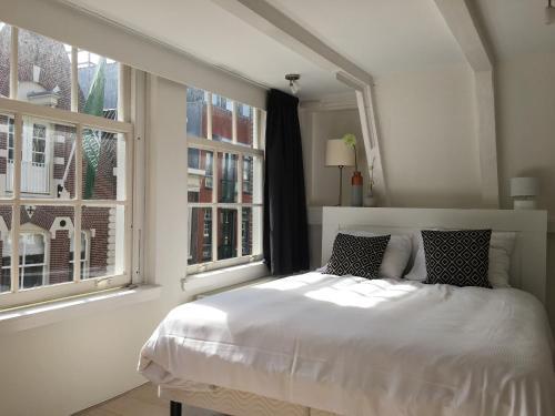 Een bed of bedden in een kamer bij Nine Streets Inn