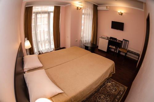 Кровать или кровати в номере Гостевой дом БоНаМи